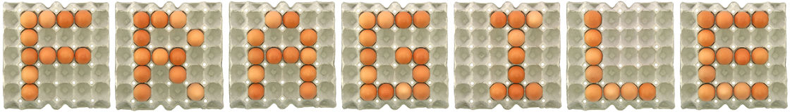 FRAGILE word from eggs in paper tray Royalty Free Stock Photos