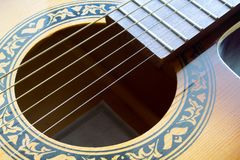Fragment of an acoustic guitar. Closeup shot royalty free stock images