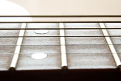 Fragment of an acoustic guitar. Closeup shot royalty free stock photography