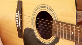 Fragment of acoustic guitar Stock Images