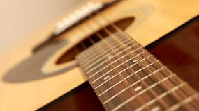 Fragment of acoustic guitar Stock Photography