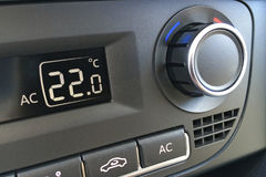 Fragment of the air conditioning control panel in a modern car closeup Stock Photos