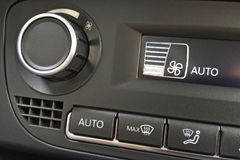 Fragment of the air conditioning control panel in a modern car closeup Royalty Free Stock Photography