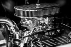 Fragment of an automobile engine close-up. Fragment air filter and carburetor of an automobile engine close up. Black and white royalty free stock photos