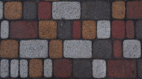 Fragment of the alley from smoothly laid bricks. Fragment of the alley from smoothly laid colored bricks Stock Images