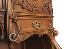 A fragment of an ancient carved furniture closeup isolated on a Royalty Free Stock Photos