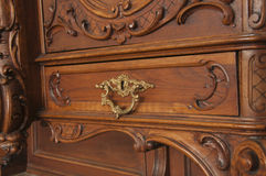 A fragment of an ancient carved furniture closeup. Wallpaper Stock Photography