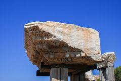 Fragment of the ancient cornice in the National Archaeological Park Caesarea. Israel royalty free stock photo