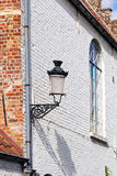 Fragment of the ancient house with a lamp and a window Stock Image