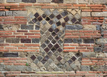 Fragment of the ancient masonry in the modern brickwall Stock Photo
