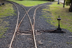 Fragment of the ancient Narrow Gage Railway with an arrow Royalty Free Stock Images