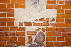 Fragment of ancient red brick wall with stones Royalty Free Stock Photography
