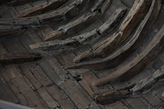 A fragment of an ancient ship, boats in the Viking Museum in Roskilde, Denmark. Viking Ship Museum and Roskilde, Denmark. Large raised from the bottom of a ship Royalty Free Stock Photo