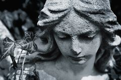 Fragment of ancient statue. Face of angel of death stock images