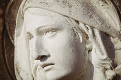 Fragment of ancient statue of Virgin Mary in profile. Religion, faith, Christianity concept.  stock images