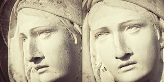 Fragment of ancient statue of Virgin Mary in profile and statue in face. Religion, faith, Christianity concept.  stock photography