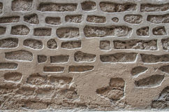 Fragment of ancient stone wall. Cement bricks in interesting pattern Royalty Free Stock Photos