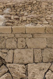 Fragment of ancient stone wall. Shore of the Mediterranean. Stock Image