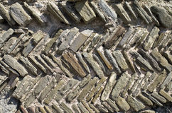 A fragment of an ancient wall. Stock Photos