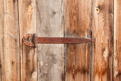 Fragment of ancient wooden door with old lock. Stock Images