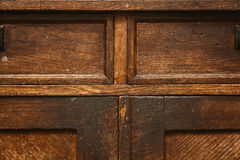Fragment of antique furniture. Vintage wood surface. grunge background, old rough texture Royalty Free Stock Photo
