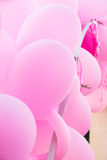 Fragment of arch decorated with pink air balloons and ribbons, birthday party, girl& x27;s baby shower, wedding, valentine. Romantic, light breezy atmosphere Royalty Free Stock Photography