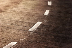 Fragment of asphalt road in the sunlight Royalty Free Stock Photography