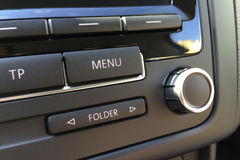 Fragment of the audio control panel in a modern car closeup stock image