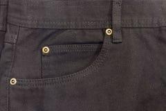 Fragment av överkanten av den nya svarta jeansen Royaltyfri Bild