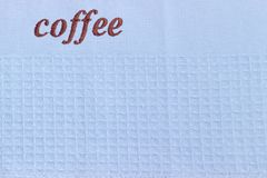 Fragment av den blåa dillandehandduken med ordkaffe Royaltyfria Bilder