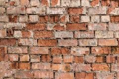 Fragment av den gamla tegelstenväggen som göras av röd tegelsten Fotografering för Bildbyråer