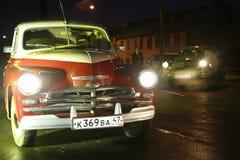 Fragment av den retro gamla bilen Volga GAZ Royaltyfria Foton