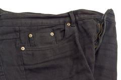 Fragment av den svarta jeansen på vit bakgrund Royaltyfria Foton