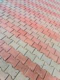 Fragment av den varicoloured trottoartegelplattan, sett abstrakt bakgrund Arkivbild