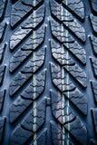 Fragment av det nya medlet, bildäck, gummihjul. Royaltyfri Fotografi