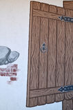 Fragment av en lista av en vägg av gästhuset Royaltyfri Bild