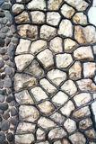 Fragment av en modern handgjord stenvägg som bakgrunder. Royaltyfri Foto