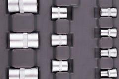 Fragment av hjälpmedel i en grå toolbox Royaltyfri Fotografi