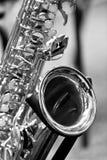 Fragment av saxofonen Arkivfoto