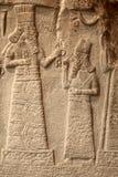 Fragment of babylonian limestone funereal stele Stock Image