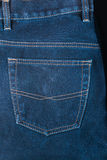 Fragment of back pocket blue jeans Royalty Free Stock Photos