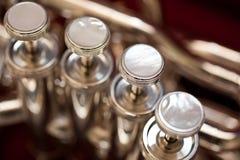 Fragment of a bass tuba valves Royalty Free Stock Photo
