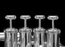 Fragment of a bass tuba valves Stock Photography