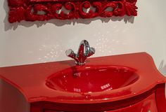 Fragment of bathroom with a red furniture. Fragment of the bathroom with red furniture royalty free stock photo