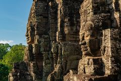 Smiling stone faces of bayon temple in cambodia royalty free stock photography