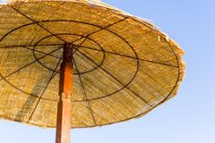 Fragment of beach umbrella or awning on a rack Royalty Free Stock Images