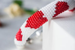 Fragment of beaded bracelet with a pattern of hearts Royalty Free Stock Images