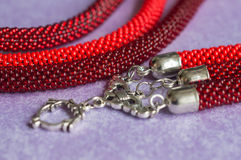 Fragment of a beaded necklace of red color Stock Images