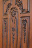 Fragment beautiful carved brown wooden door Royalty Free Stock Image