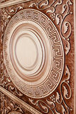 Fragment beautiful carved brown wooden door Stock Photos